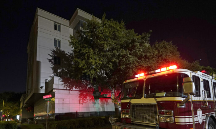 A firetruck is positioned outside the Chinese Consulate Wednesday, July 22, 2020, in Houston.  (AP Photo/David J. Phillip)