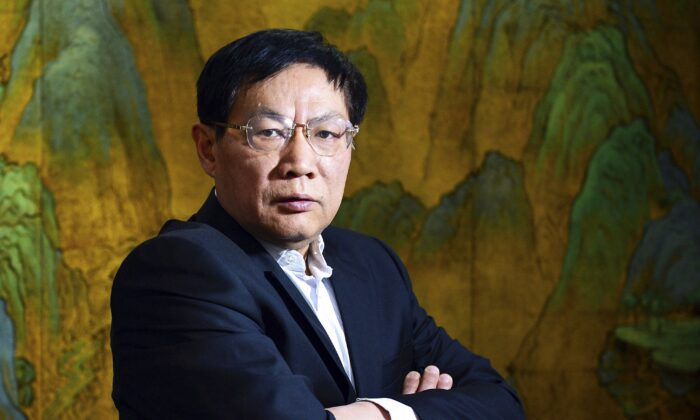 Chinese real estate mogul Ren Zhiqiang poses for photos in his office in Beijing on Dec. 3, 2012. (Color China Photo via AP)