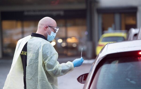 Chief doctor Germra Schneider at the emergency department in municipality Asker and Baerum tests a person for the novel coronavirus in a car outside the emergency unit on March 2, 2020 in Sandvika, Norway. - Medical staff handle the testing this way to avoid sick people in the waiting room. The European Union's disease control agency has increased its risk level for the novel coronavirus COVID-19 from moderate to high, EU Commission president Ursula von der Leyen said Monday, March 2, 2020. (Photo by Terje Bendiksby / NTB Scanpix / AFP) / Norway OUT (Photo by TERJE BENDIKSBY/NTB Scanpix/AFP via Getty Images)