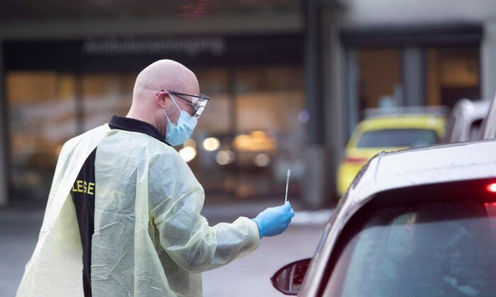 Chief doctor Germra Schneider tests a person for the novel coronavirus in a car outside the emergency unit in Sandvika, Norway, on March 2, 2020. (Terje Bendiksby / NTB Scanpix / AFP via Getty Images).