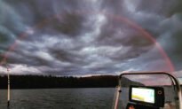 A Rare Spectacle: Fisherman Captures a Stunning Image of a Red Rainbow Over Finnish Lake