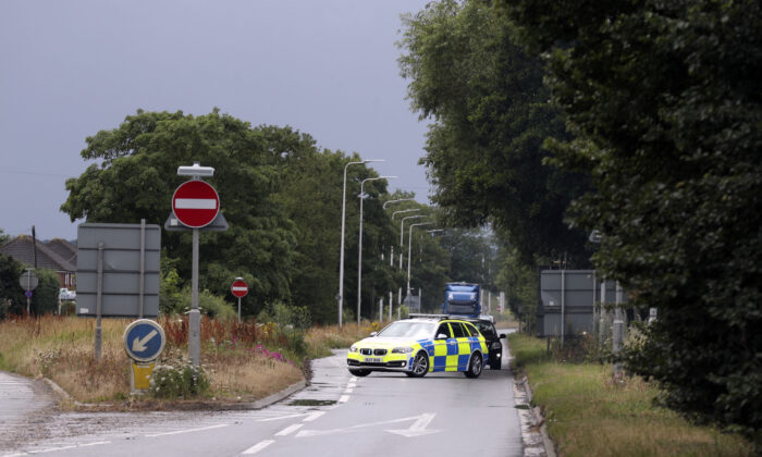 A police car closes the A4 during the Old Bailey jury site visit to scene where PC Andrew Harper died in Sulhamstead, United Kingdom, on July 1, 2020. The 28-year-old police officer died after being dragged behind a car after responding to a reported quad bike theft in August 2019. (Steve Parsons - WPA Pool/Getty Images)