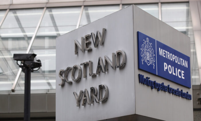 File photo of a general view of the sign at the New Scotland Yard building in Victoria on January 27, 2011, in London, England.  (Oli Scarff/Getty Images)