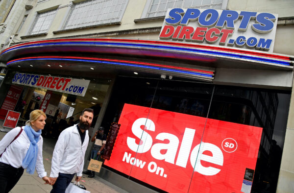 Shoppers walk past a branch of Sports Direct in Oxford Street London