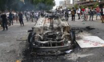 Man Charged for Allegedly Helping Torch Police Car During Riots