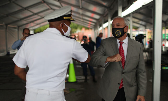Miami-Dade County Mayor Carlos Gimenez, right, greets Surgeon General Jerome Adams at a new federally funded COVID-19 testing site at the Miami-Dade County Auditorium in Miami, Fla., on July 23, 2020. (Joe Raedle/Getty Images)