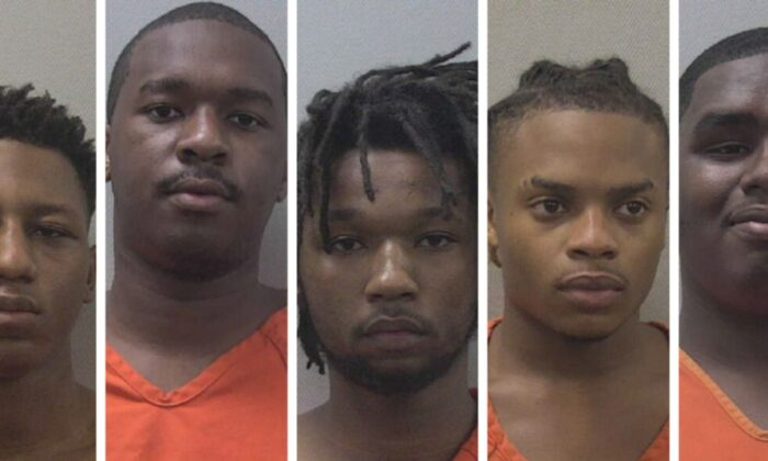Five UPS employees were arrested last week in connection with firearms that were stolen from the company's shipping hub in West Columbia, South Carolina, officials said. (Lexington SC Sheriff's Office)