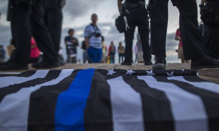 A flag with the thin blue line, which is used to honor police officers, lies on a boardwalk in a file photograph. (David McNew/Getty Images)