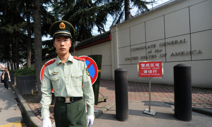 A Chinese paramilitary policeman stands guard at the entrance of the US consulate in Chengdu, southwest China's Sichuan province on Sept. 17, 2012. (Goh Chai Hin/AFP/GettyImages)