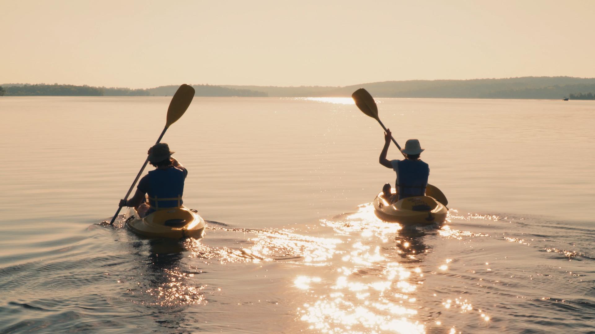 Elmhirsts - Kayak Couple Paddling Into Sunlight