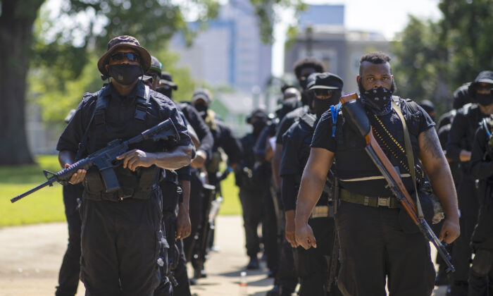 Members of a protestor group affiliated with NFAC, most carrying firearms, gather to march in Louisville, Ky., on July 25, 2020. (Brett Carlsen/Getty Images)