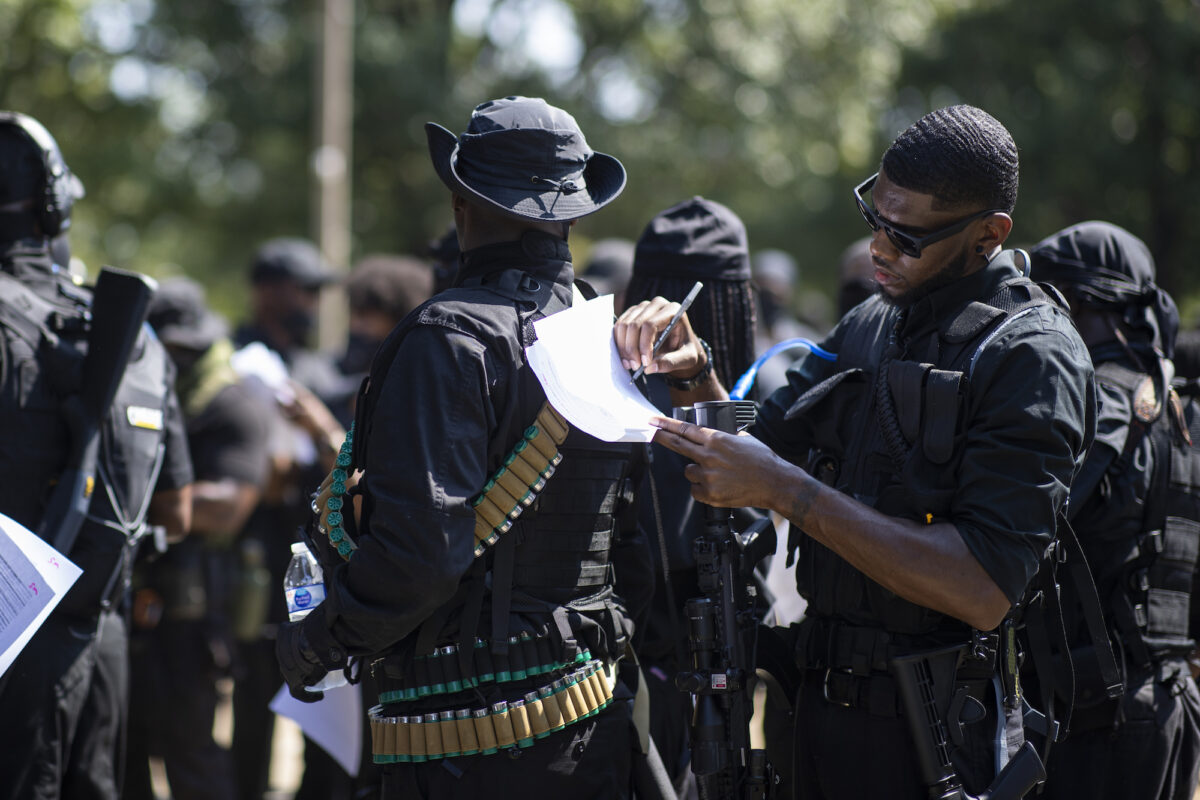 Armed protesters march in Kentucky demanding justice for Breonna Taylor