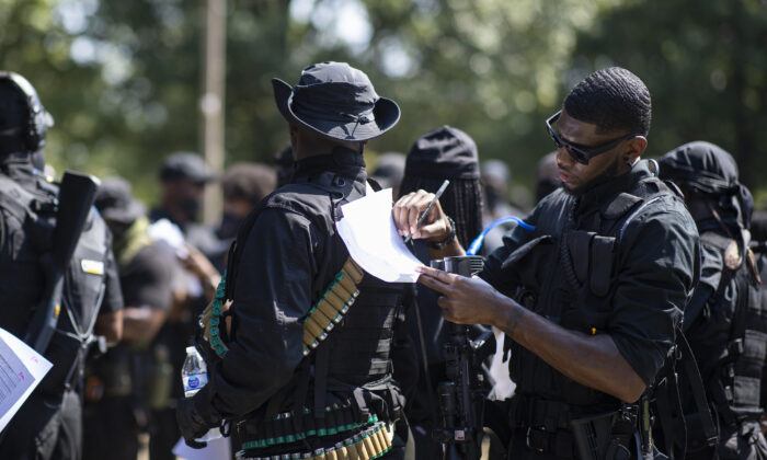 Members of a protest group affiliated with NFAC, most carrying firearms, gather to march in Louisville, Ky, on July 25, 2020. (Brett Carlsen/Getty Images)