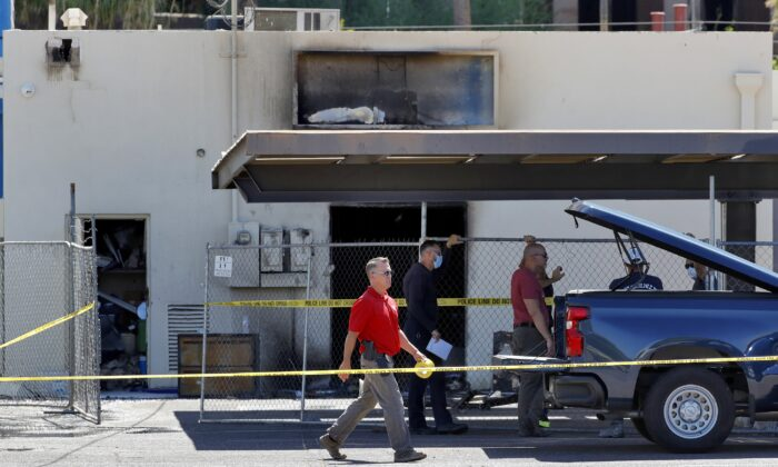 Fire investigators stand outside the Arizona Democratic Party headquarters in Phoenix, Ariz., on July 24, 2020. (Matt York/AP Photo)