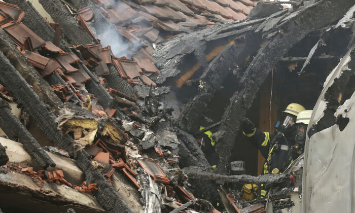 Emergency services attend the scene after a light plane crashed into an apartment building in Wesel, Germany, on July 25, 2020. David Young/dpa via AP)