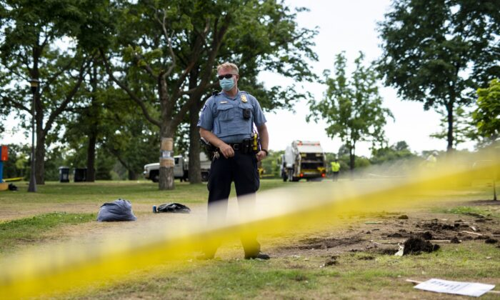 A Minneapolis police officer stands in a park in Minneapolis, Minn., on July 20, 2020. (Stephen Maturen/Getty Images)