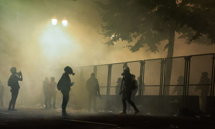 Rioters are surrounded by tear gas near the Mark O. Hatfield Courthouse in Portland, Ore., late July 24, 2020. (Kathryn Elsesser/AFP via Getty Images)