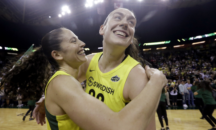 This Sept. 4, 2018, file photo shows Seattle Storm's Sue Bird, left, and Breanna Stewart embracing after the Storm defeated the Phoenix Mercury 94-84 during Game 5 of a WNBA basketball playoff semifinal, in Seattle. (AP Photo/Elaine Thompson)