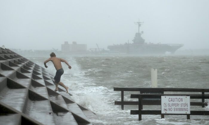 A man jumps from a wave as Hurricane Hanna begins to make landfall, in Corpus Christi, Texas, on July 25, 2020. (Eric Gay/AP Photo)