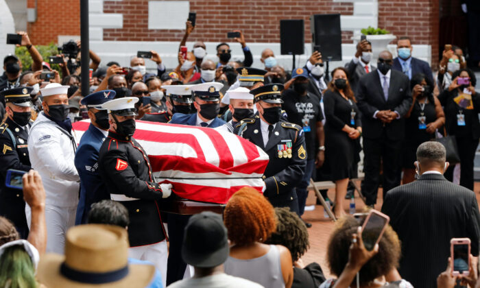 The casket of late U.S. Congressman John Lewis, a pioneer of the civil rights movement and long-time member of the U.S. House of Representatives who died July 17, is carried outside the Brown Chapel A.M.E. Church in Selma, Ala., July 26, 2020. Chris (Aluka Berry/Reuters)