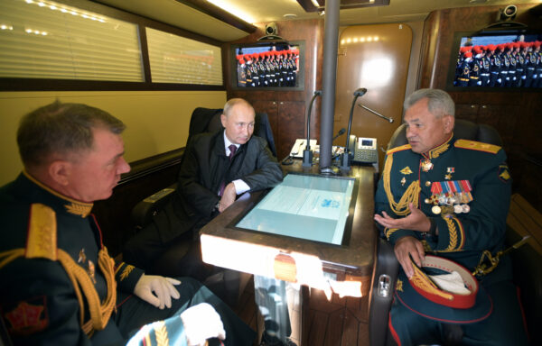 Russian President Vladimir Putin, Defence Minister Sergei Shoigu and Commander of the Western Military District of Russian Armed Forces Alexander Zhuravlyov
