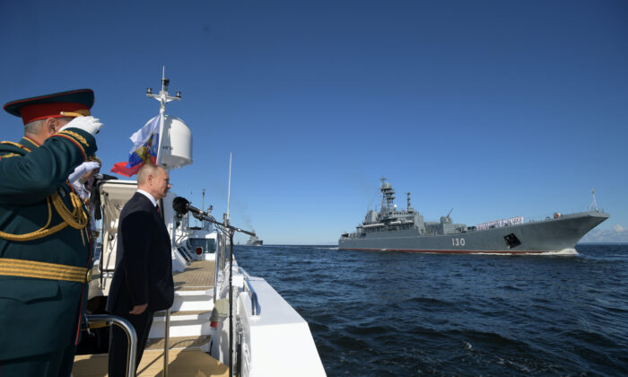 Russia's President Vladimir Putin inspects warships before the Navy Day parade in Saint Petersburg, Russia, on July 26, 2020. (Sputnik/Alexei Druzhinin/Kremlin via Renters)