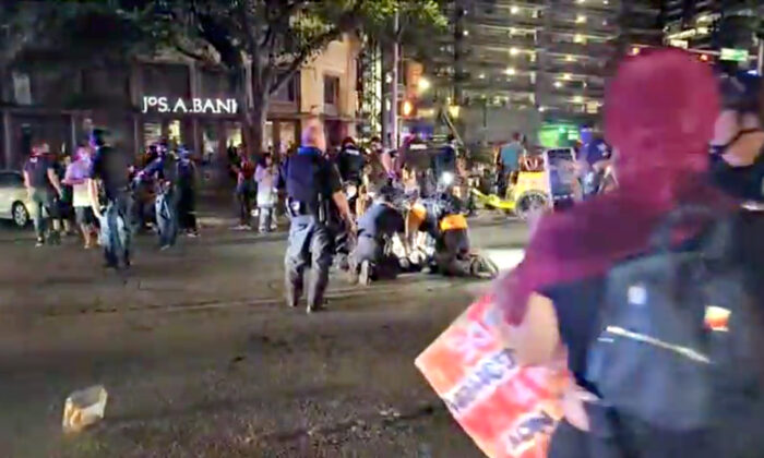 Police and protesters gather around a demonstrator who got shot after several shots were fired during a Black Lives Matter protest in downtown Austin, Texas, on July 25, 2020 in this screen grab obtained from a social media video. (ImHiram/Hiram Gilberto/www.imhiram.com via Reuters)