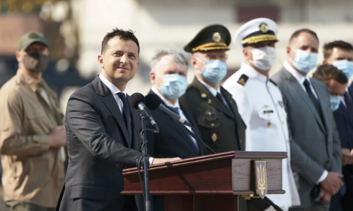 Ukrainian President Volodymyr Zelenskiy, foreground, and high-ranking officials wearing face masks to protect against coronavirus watch a navy parade on Ukraine's Navy Day in the Black Sea Port of Odesa, Ukraine, on July 5, 2020. (Ukrainian Presidential Press Office/AP Photo)