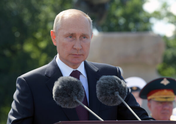 Vladimir Putin delivers a speech during the Navy Day parade