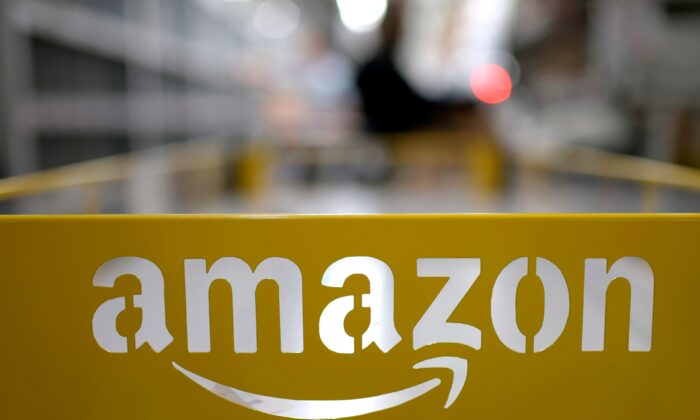 This picture shows the logo of U.S. online retail giant Amazon at the distribution center in Moenchengladbach, western Germany, on Dec. 17, 2019. (Ina Fassbender/AFP via Getty Images)