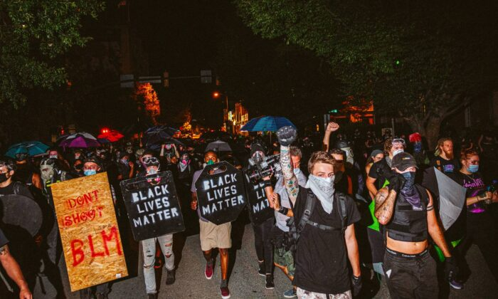 People carrying homemade Black Lives Matter shields march in front of protesters on July 25, 2020 in Richmond, Virginia. (Eze Amos/Getty Images)