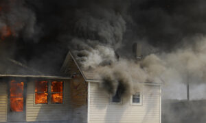 Buckeye Police and Fire Chiefs Rescue Children, Pets Trapped Inside a Burning House