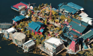 Couple Lives on a Self-Sustaining Floating Island That They Built Themselves for 29 Years