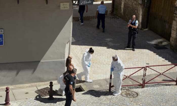 French police stand next to a storm drain where the body of Laure Bardina-Kruger was found, in Peyriac de Mer, southern France, on July 24, 2020. (Christophe Barreau/AP Photo)