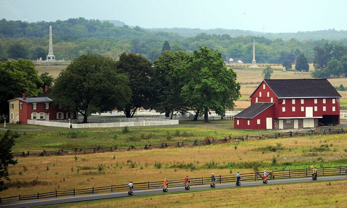 A Segway tour passes the historic Codori farm, which sits in the heart of the battle field on August 11, 2010, at Gettysburg National Military Park. (KAREN BLEIER/AFP via Getty Images)
