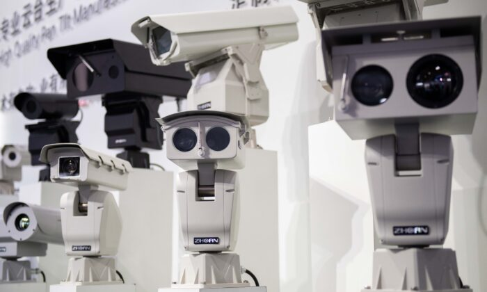 AI (artificial intelligence) security cameras using facial recognition technology are displayed at the 14th China International Exhibition on Public Safety and Security at the China International Exhibition Center in Beijing, China, on Oct. 24, 2018. (Nicolas Asfouri/AFP via Getty Images)