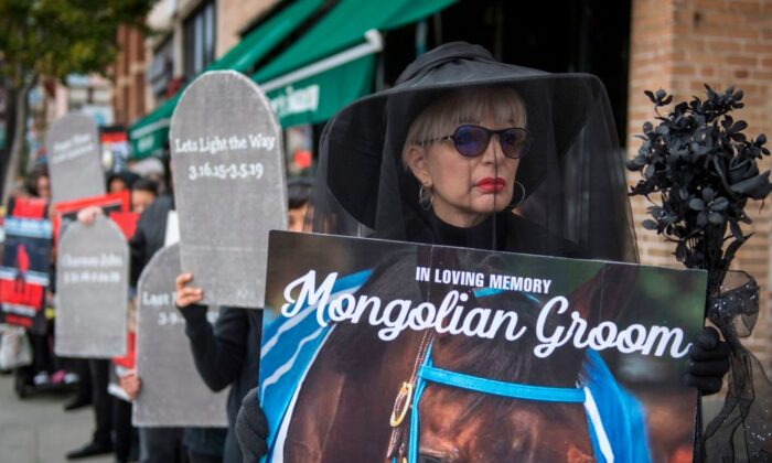"Members of the group Horseracing Wrongs and their supporters hold a ""Requiem March for the fallen horses,"" in Pasadena, Calif., on Nov. 30, 2019. (Mark Ralston/AFP via Getty Images)"