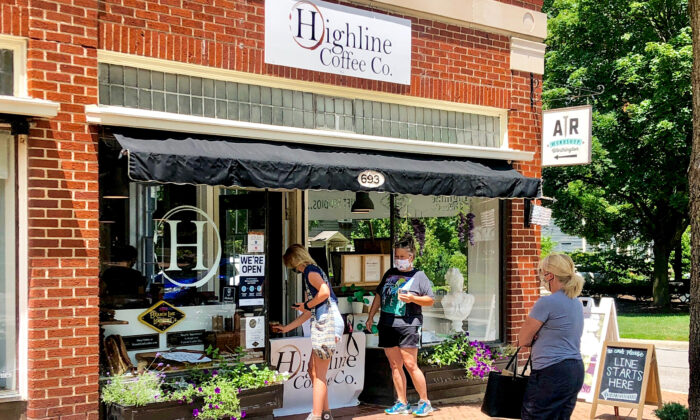 Shoppers buy coffee via the walk-up window at Highline Coffee Co., in the historic Worthington district of Columbus, Ohio, on July 11, 2020. (Seth Holehouse for The Epoch Times)