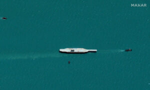 Iran Moves Mock-Up US Carrier to Mouth of Gulf: Satellite Images
