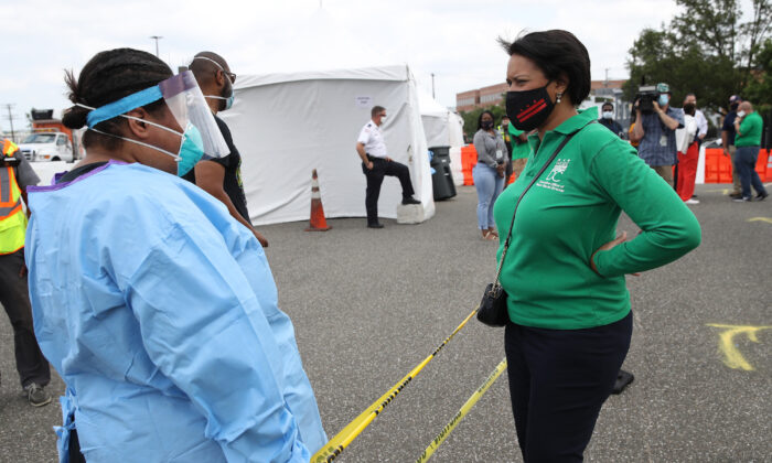 Washington Mayor Muriel Bowser greets nurses before being tested for COVID-19 at a testing site in Washington, on June 10, 2020. (Win McNamee/Getty Images)