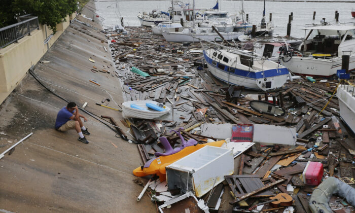 Allen Heath surveys the damage to a private marina after it was hit by Hurricane Hanna, in Corpus Christi, Texas, on July 26, 2020. (Eric Gay/AP Photo)