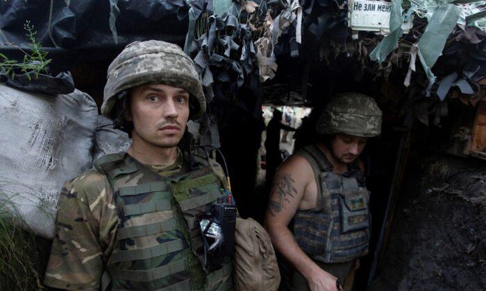 Ukrainian servicemen are seen at a position on the front line near the town of Novotoshkivske in Luhansk region, Ukraine, on July 26, 2020. (Iryna Rybakova/Press Service of Ukrainian Defence Ministry/Handout via Reuters)