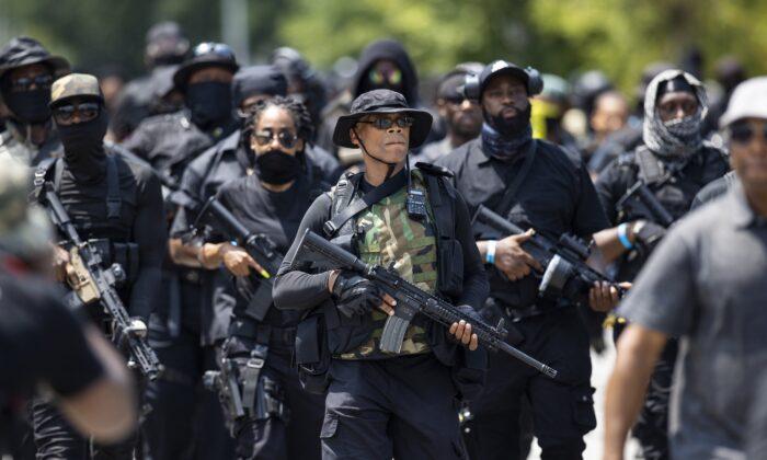 Grandmaster Jay, left, leader of NFAC, leads a march in Louisville, Ky., on July 25, 2020. (Brett Carlsen/Getty Images)