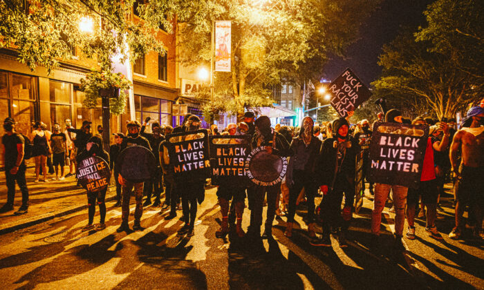 People carrying homemade Black Lives Matter shields march in front of protesters in Richmond, Virginia, on July 25, 2020. (Eze Amos/Getty Images)