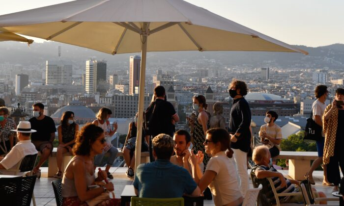 People sit at a terrace bar near the National Art Museum of Barcelona (MNAC) in Barcelona on July 25, 2020. (Pau Barrena/AFP via Getty Images)