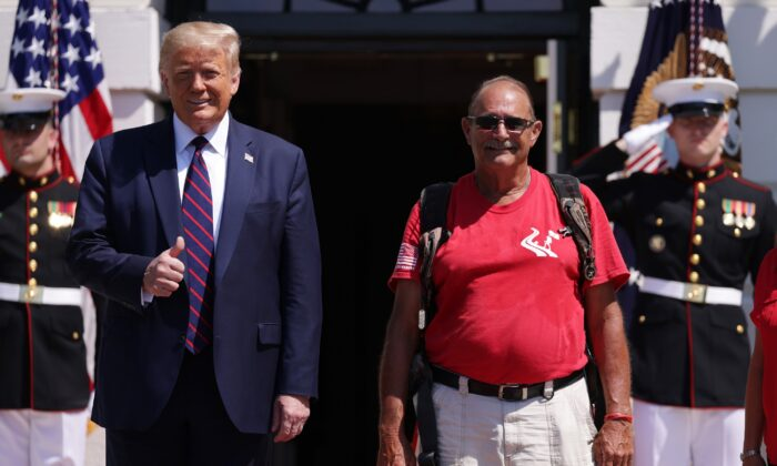 "President Donald Trump greets the ""Walking Marine"" Terry Sharpe at the White House in Washington on July 27, 2020. (Alex Wong/Getty Images)"