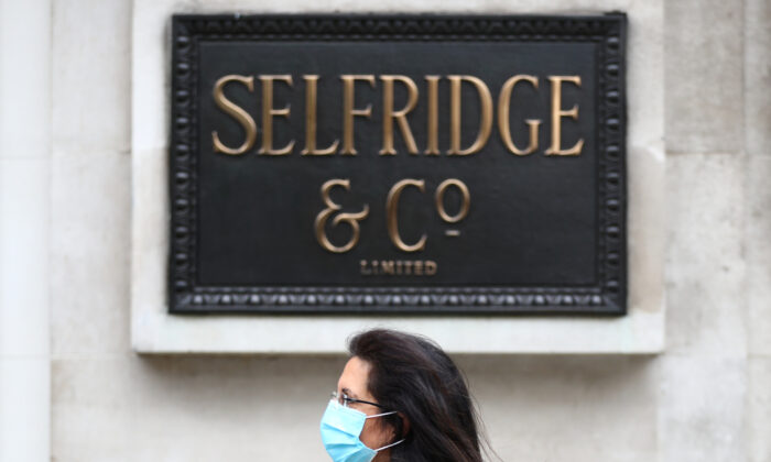 A woman wearing a protective mask walks past a Selfridges store at Oxford Street, amid the coronavirus disease (COVID-19) outbreak, in London, Britain, on July 28, 2020. (Hannah McKay/Reuters)