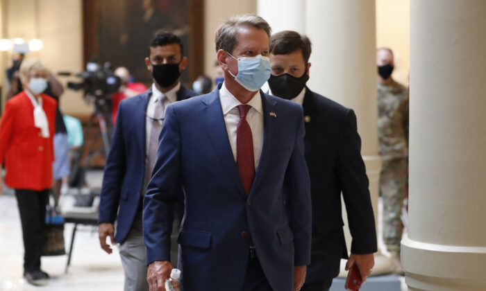 Georgia Gov. Brian Kemp returns to his office after giving a coronavirus briefing at the Capitol in Atlanta, Ga., on  July 17, 2020. (John Bazemore/ File/AP Photo)