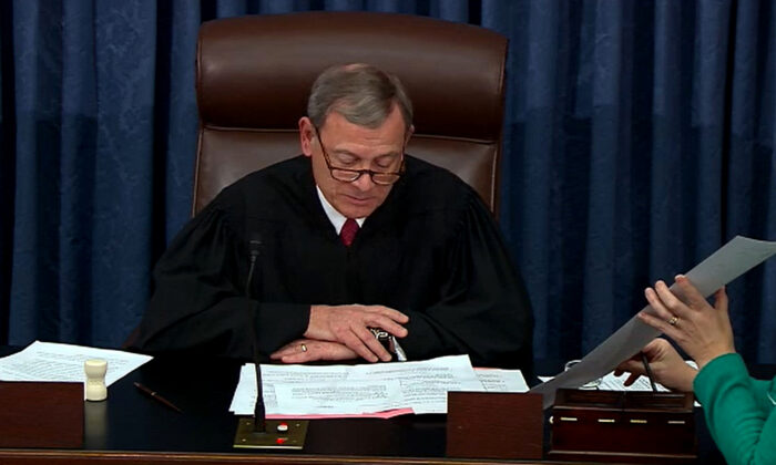 Chief Justice John Roberts announces the results of the vote on the second article of impeachment during impeachment proceedings against President Donald Trump in the Senate at the Capitol in Washington on Feb. 5, 2020. (Senate Television via Getty Images)