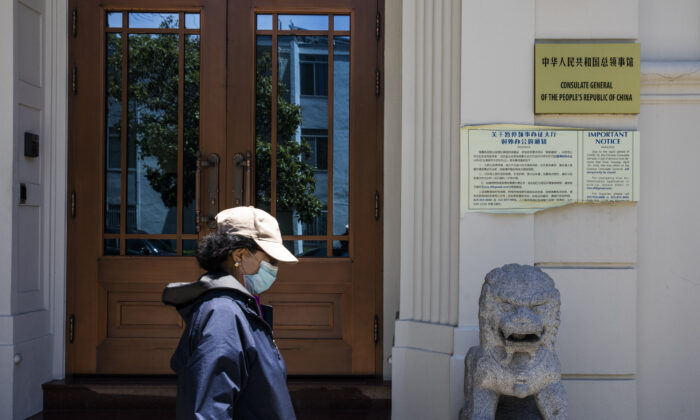 A person walks past the Consulate General of the People's Republic of China in San Francisco on July 23, 2020.  (PHILIP PACHECO/AFP via Getty Images)